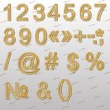 Éléments de conception - police, signes et symboles du fil 3D d'or Photos stock