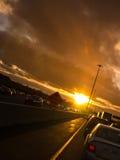 Κολλημένος στην κυκλοφορία ηλιοβασιλέματος στη 'Οικία' τρόπων Στοκ Εικόνα