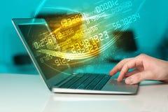 供以人员键入在有数字技术数据来的现代笔记本 图库摄影