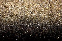圣诞节新年黑色和金子闪烁背景 假日抽象纹理织品 免版税图库摄影