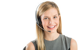 确信的客户服务代表佩带的耳机 图库摄影