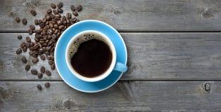 背景豆咖啡杯 免版税图库摄影