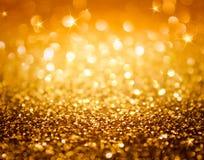 金黄闪烁和星圣诞节背景的 免版税库存图片