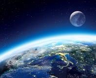 Aarde en maanmening van ruimte bij nacht Royalty-vrije Stock Foto