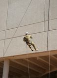 Abseiling down the wall Royalty Free Stock Photos