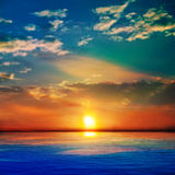 Abstract blue nature background with sea unset and clouds Stock Image