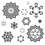 Abstrakta beståndsdelar - stjärnor, gnistor, blommor, snowlakes Arkivbild