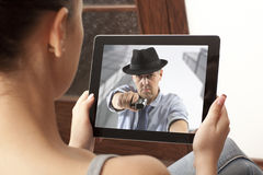 Action  movie on tablet Stock Photography