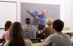 Adult students with teacher in classroom Royalty Free Stock Photo