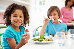 African American Family Eating Meal At Home Together Stock Photo