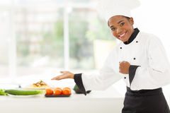 African female chef presenting Royalty Free Stock Photos