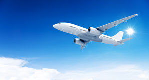 Airplane mid in the air and Blue Sky Royalty Free Stock Photography
