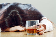 Alcoholic drink and sleeping Royalty Free Stock Photography