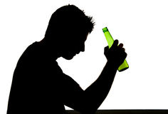 Alcoholic drunk man with beer bottle in alcohol addiction silhouette Stock Photography