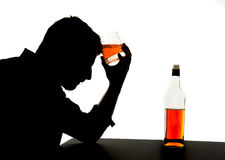 Alcoholic drunk man with whiskey glass in alcohol addiction silhouette Royalty Free Stock Photos