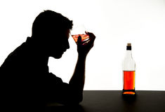 Alcoholic drunk man with whiskey glass in alcohol addiction silhouette Royalty Free Stock Images