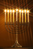 All candle lite on the traditional Hanukkah menorah with star filter Stock Image