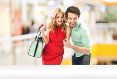 Amazed couple looking at the occasion Royalty Free Stock Photo