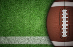 American Football Ball on Grass Royalty Free Stock Photography