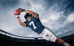 American Football Player Catching a touchdown Pass Royalty Free Stock Photo
