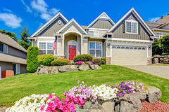 American house with beautiful landscape and vivid flowers Royalty Free Stock Photography