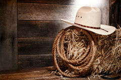 American West Rodeo Cowboy Straw Hat on Hay Bale Royalty Free Stock Photo
