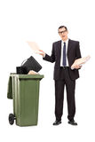 Angry businessman throwing his stuff in the trash Stock Photography