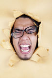 Angry Young Man with Glasses Royalty Free Stock Images