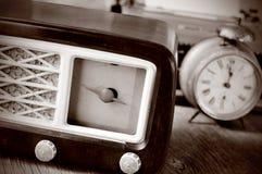 Antique radio, alarm clock and typewriter, in sepia toning Stock Image