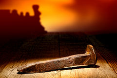 Antique Rusty Railroad Rail Spike Tie on Old Wood Stock Photos