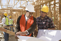 Architect And Foreman Having Discussion Over Blueprint Royalty Free Stock Photos