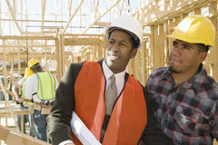 Architect With Foreman Inspecting Framework Royalty Free Stock Image
