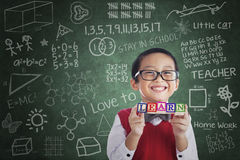Asian boy student hold learn block in class Royalty Free Stock Photos