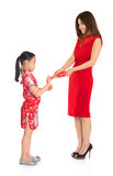 Asian Chinese child receiving monetary gift from parent Stock Photography