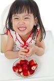 Asian Chinese little girl eating strawberries Stock Photo