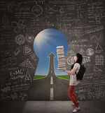 Asian female student bring books with success road and keyhole Stock Photo
