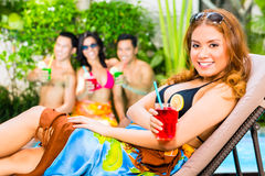 Asian friends partying at pool party in hotel Royalty Free Stock Photos
