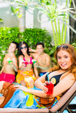 Asian friends partying at pool party in hotel Stock Photo