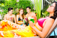 Asian friends partying at pool party in resort Stock Images