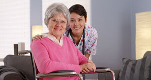 Asian nurse smiling with Elderly patient Stock Image
