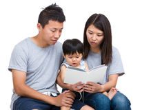 Asian parent reading booking with baby son Royalty Free Stock Photo