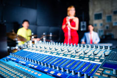 Asian professional band in recording studio mixing Stock Image
