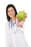 Asian Woman Nurse with Apple Stock Image