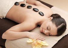 Asian woman in spa with hot stones Royalty Free Stock Photo