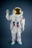 Astronaut saying hi on a grey background Royalty Free Stock Image