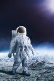 Astronaut walking on the moon Stock Photo