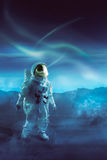 Astronaut walking on an unexplored planet Royalty Free Stock Photo