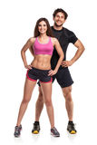 Athletic  man and woman after fitness exercise on the white back Royalty Free Stock Photography