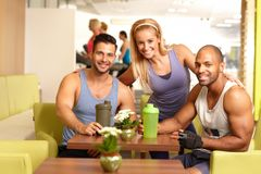 Athletic young people in gym Stock Photos