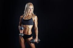 Athletic young woman doing a fitness workout with dumbbels Royalty Free Stock Photography